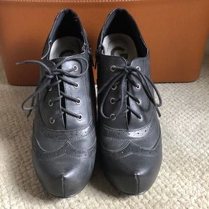 Black Oxford booties by Guess